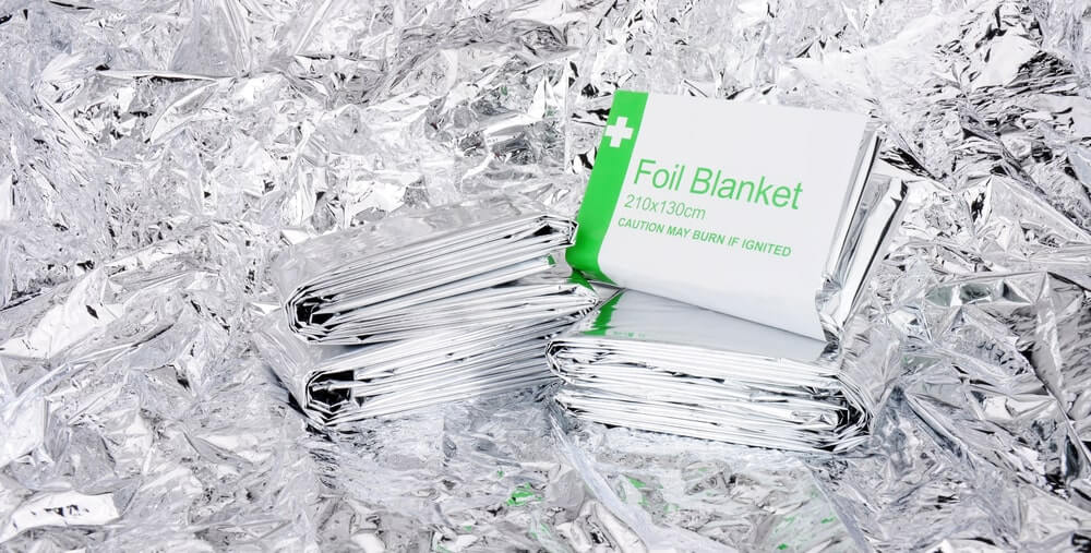 Emergency foil space blankets with a foil backgroun