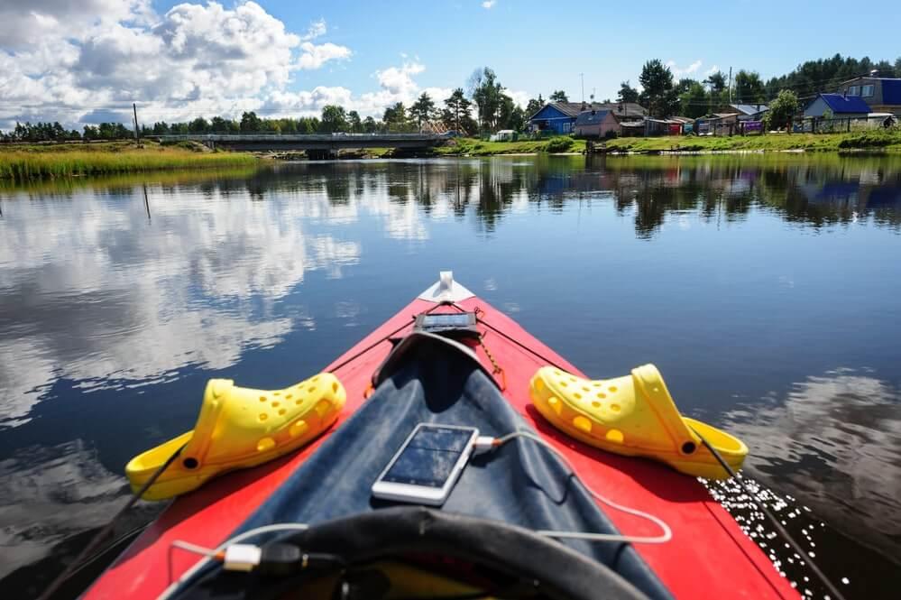 A pair of crocs on a kayak