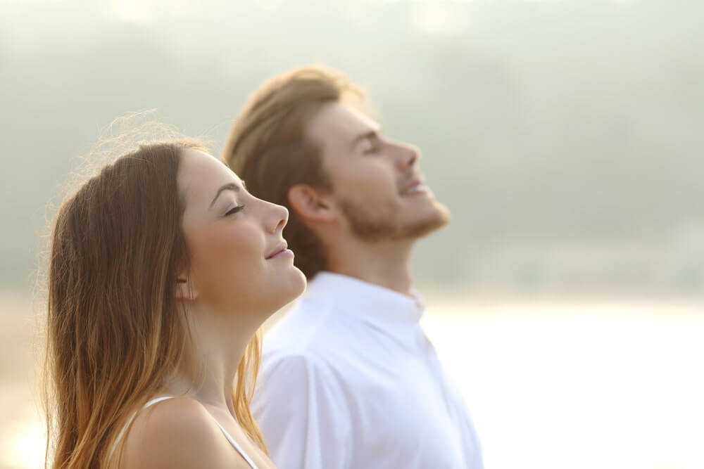 Couple of man and woman breathing deep fresh ai